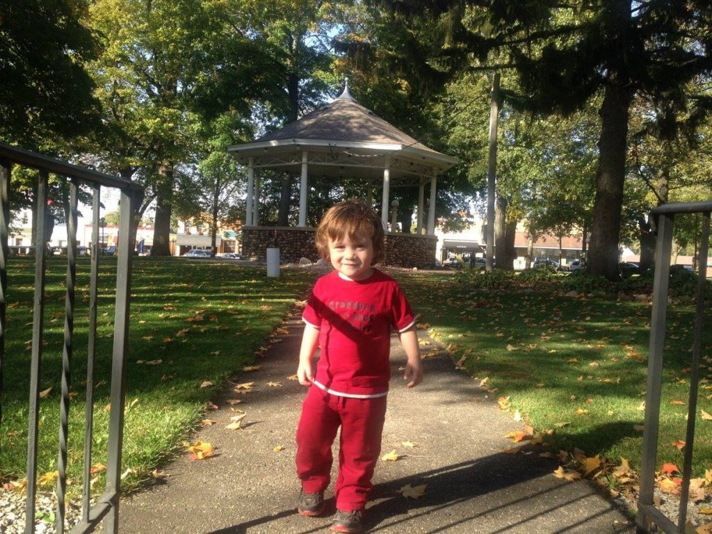 My youngest son, Jamie, playing last year in the town square park. Many of the trees are 150 years old.